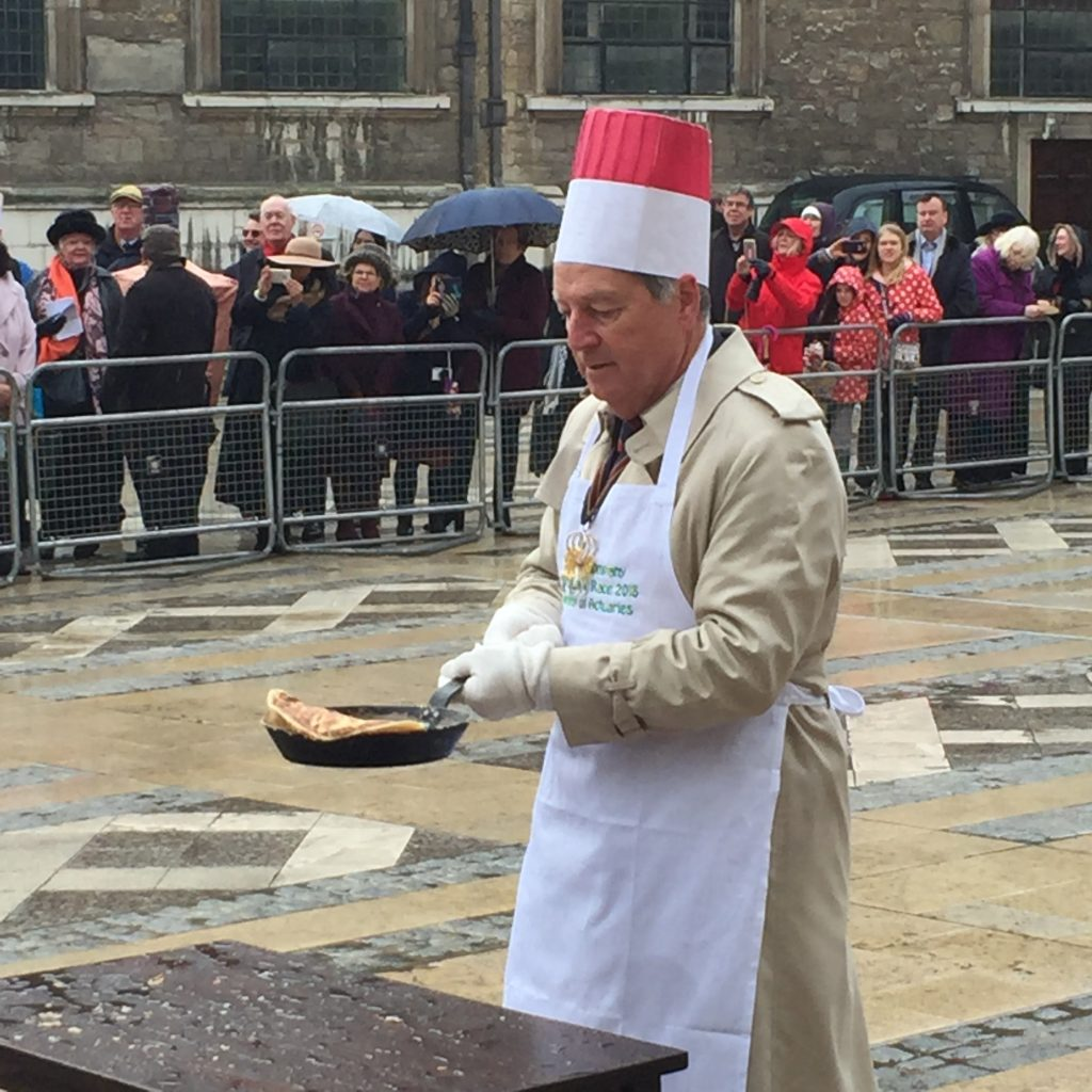 Senior Warden tossing a pancake Feb 2018