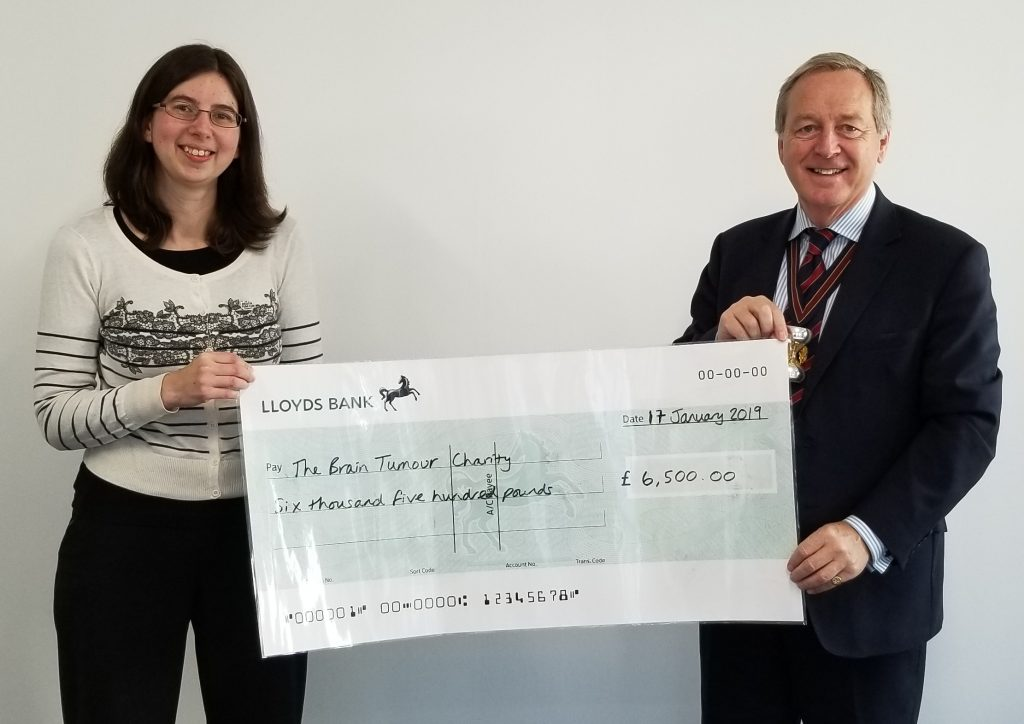 Masters' walk cheque to Brain Tumour charity